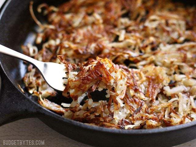 Close up of forkful of Crispy Hash Browns