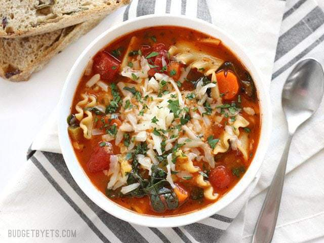 Finished bowl of Garden Vegetable Lasagna soup with bread on the side