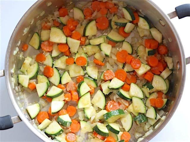 Sauté Zucchini and Carrot in soup pot with onion and garlic
