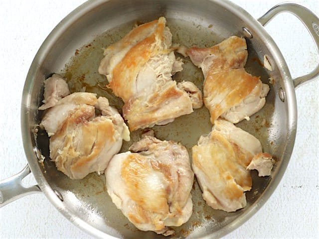 Browned Chicken Thighs in a deep skillet