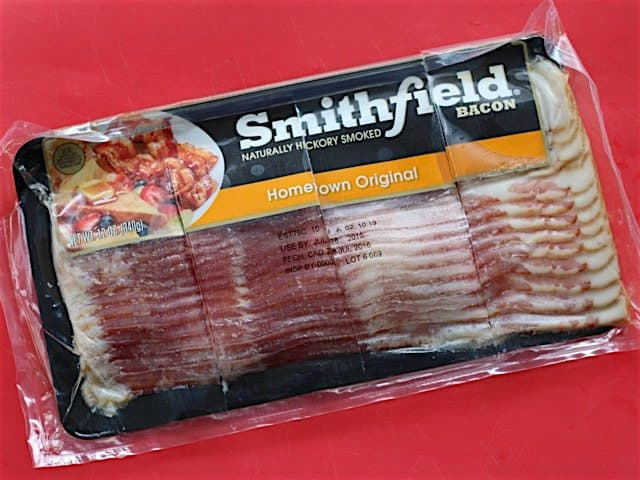 A package of bacon cut into 3 oz. portions