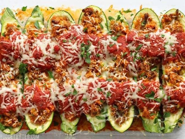 Baked Italian Sausage Stuffed Zucchini Boats in the glass casserole dish