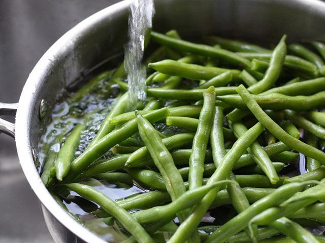 Add one inch of water to a skillet full of fresh green beans