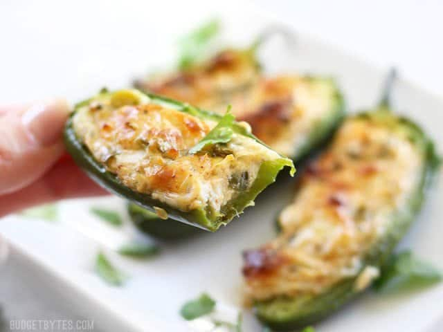 Cheesy Scallion Stuffed Jalapeños are a quick and impressive appetizer for any party or game night. BudgetBytes.com