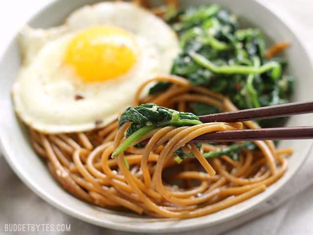Sesame Noodles with Wilted Greens is a simple dinner with big flavor and plenty of options for customization. BudgetBytes.com