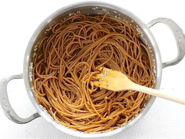 Sesame Noodles in the pot with a wooden pasta fork