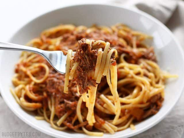 Close up of a forkful of Sunday Slow Cooker Beef Ragù