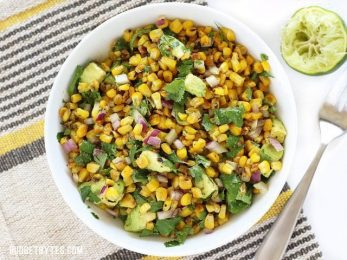 Warm Corn and Avocado Salad makes the perfect light and fresh side for enchiladas, grilled meats, or tacos. BudgetBytes.com