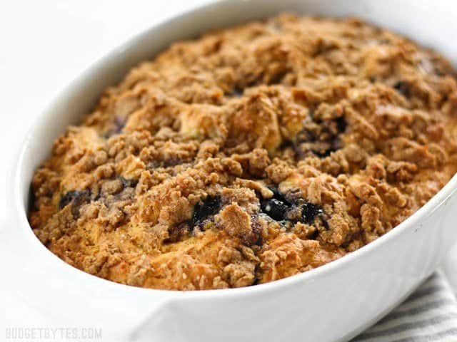 View of the top of a Blueberry Buttermilk Coffee Cake in a casserole dish
