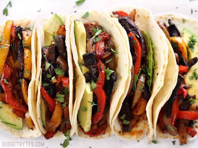 Close up of filled Chipotle Portobello Oven Fajitas lined up in a row