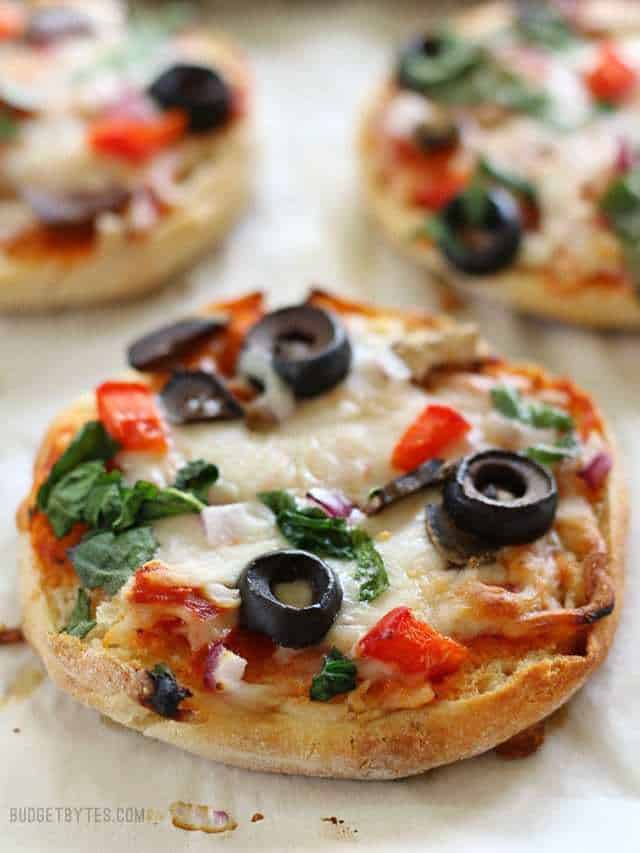 Close up of baked Freezer Ready Mini Pizzas on a baking sheet.