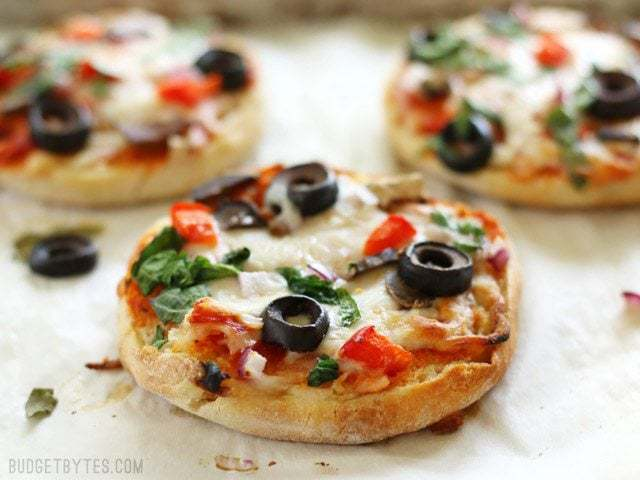 Freezer Ready Mini Pizzas are an easy and inexpensive snack to keep on hand in your freezer. BudgetBytes.com