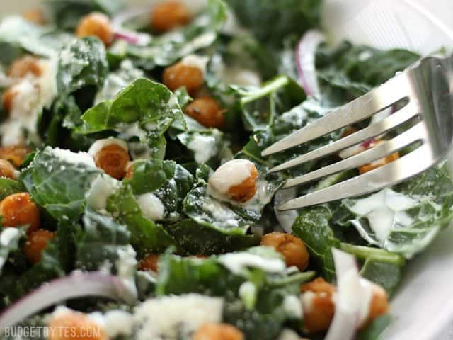 Close up of a fork about to dig into the Kale Salad with Cajun Spiced Chickpeas and Buttermilk Dressing