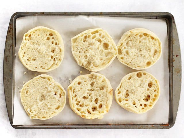 Naked English Muffins on a parchment lined baking sheet