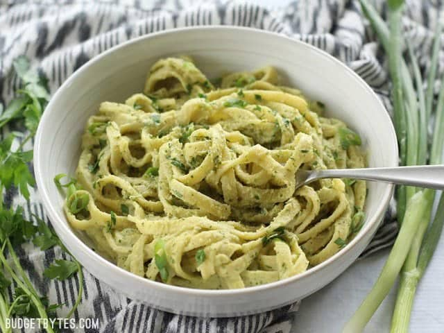 Parsley Scallion Hummus Pasta - Hummus makes a wonderfully creamy vegan pasta sauce for summer. BudgetBytes.com