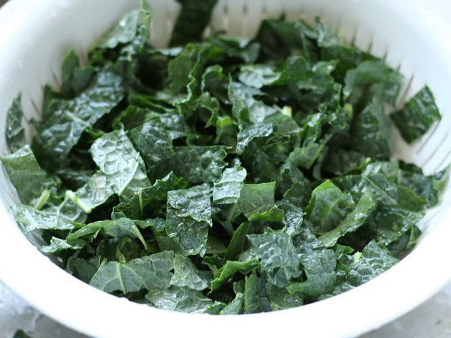 Rinse Kale in colander
