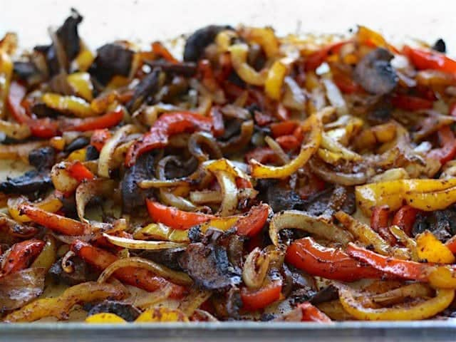 Roasted chipotle portobello mushrooms, bell peppers, and onions in a baking dish