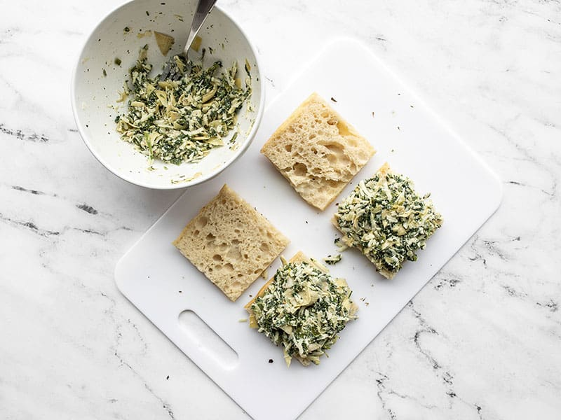Spinach artichoke filling added to pieces of focaccia