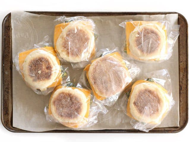 Freezer breakfast sandwiches wrapped in sandwich bags, ready to freeze