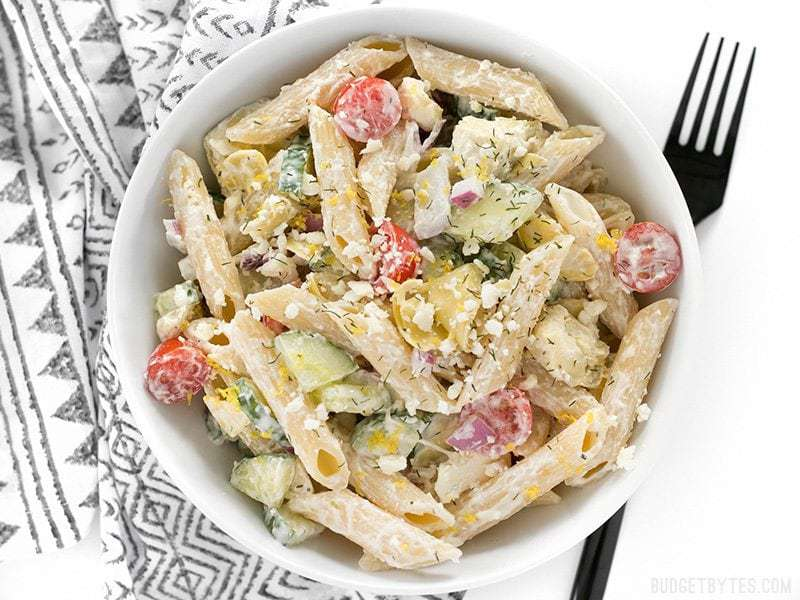 Overhead view of Creamy Lemon Dill Greek Pasta Salad with a black fork on the side
