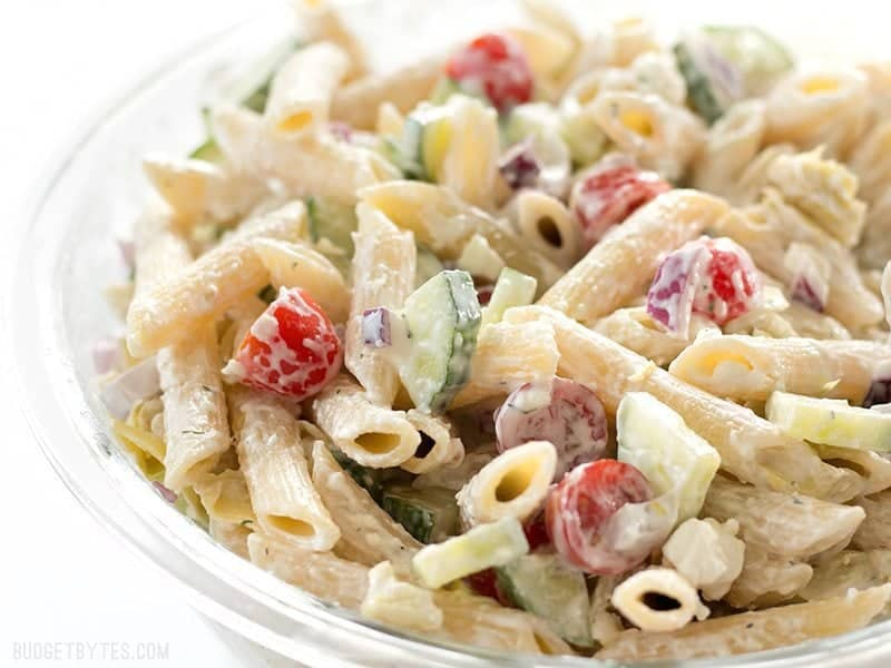 Side view of Creamy Lemon Dill Greek Pasta Salad in a glass bowl