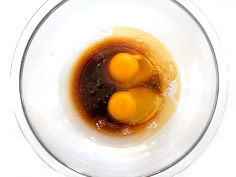 Eggs Soy Sauce Sesame Oil and Water in a bowl