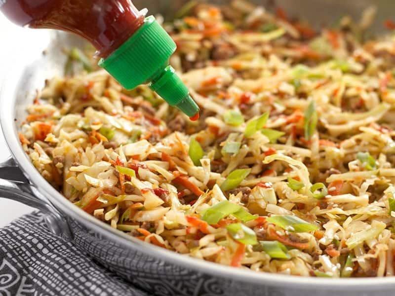 Garnish with Sriracha and Sesame Seeds