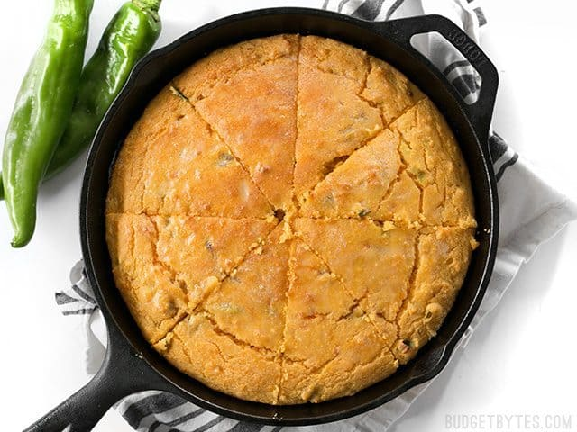 Top view of sliced Hatch Chile Sweet Potato Cornbread in cast iron skillet