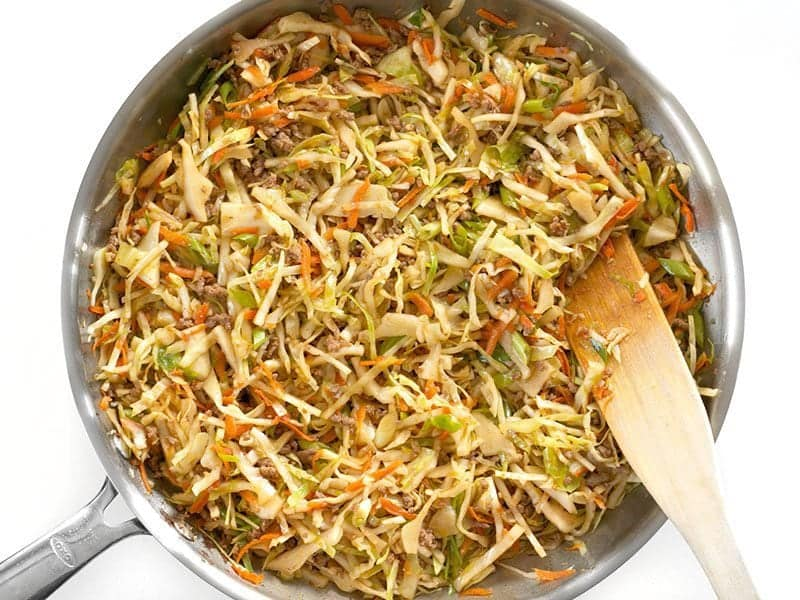 Mix in Green Onion into Beef and Cabbage Stir Fry