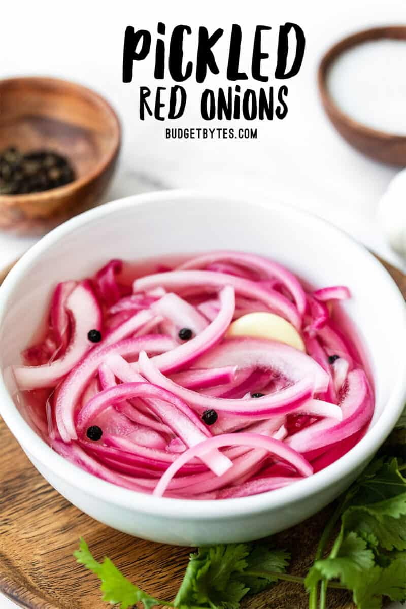Front view of a bowl of pickled red onions with title text at the top