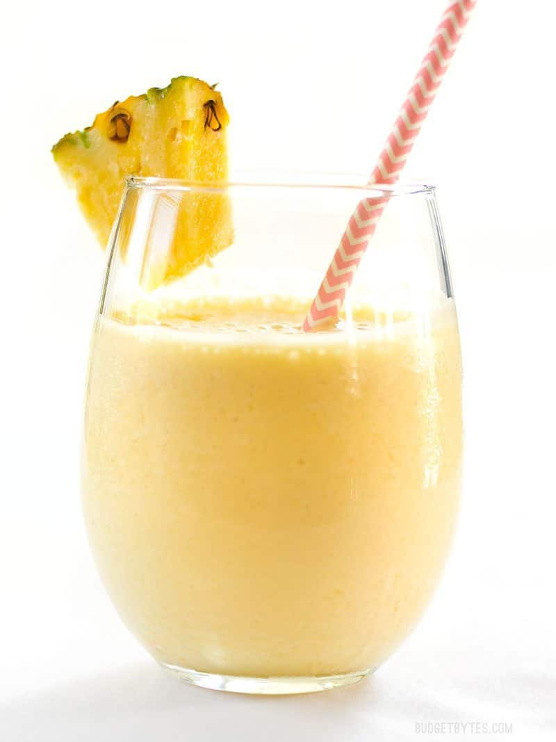 When you need a tropical escape this homemade Pineapple Orange Julius is the perfect sweet and creamy frozen drink to take you away. BudgetBytes.com