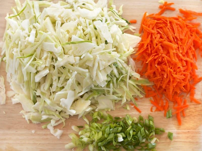 Shredded cabbage, carrot, and sliced green onion