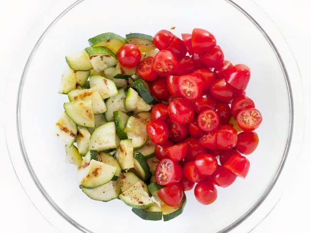 Chopped Zucchini and Tomato in a glass bowl