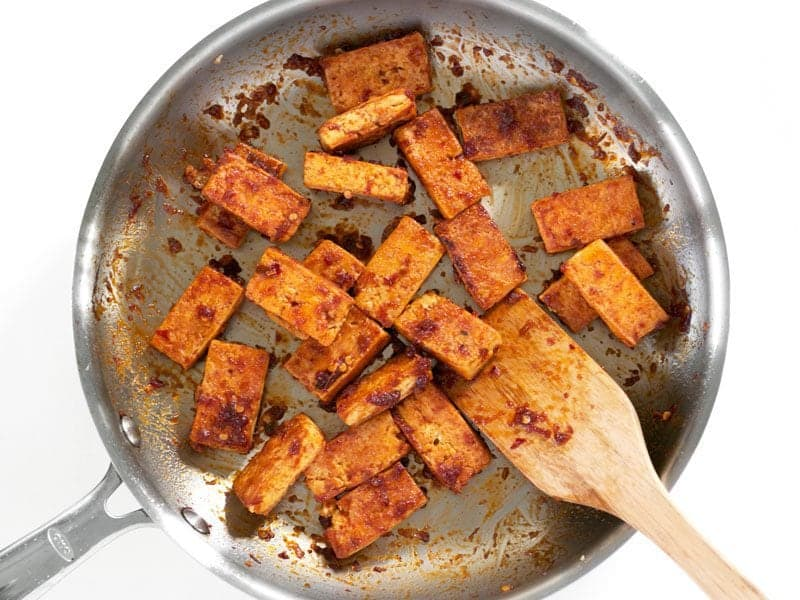 Add Chili Garlic Sauce to fried tofu in skillet