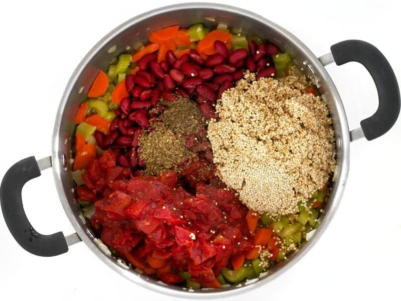 Add Quinoa Beans Tomatoes and Spices to the pot