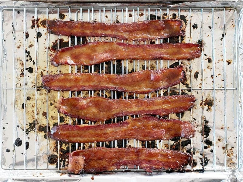 Cooked Brown Sugar Bacon on the baking sheet