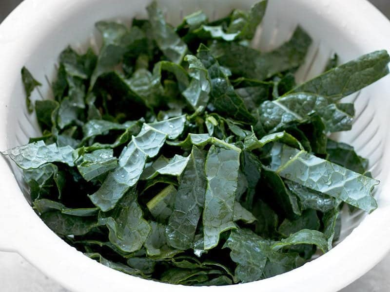 Kale cut into strips and rinsed in a colander