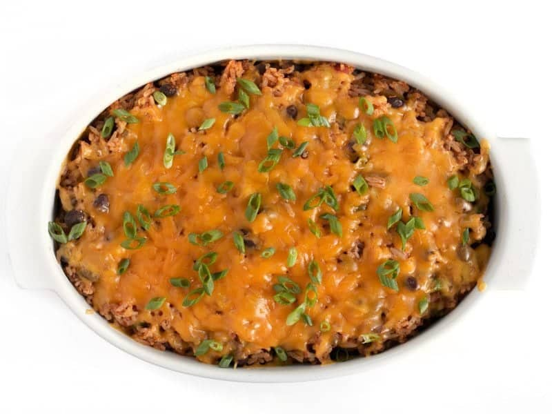 Beef Burrito Casserole baked with cheese on top, garnished with sliced green onions.