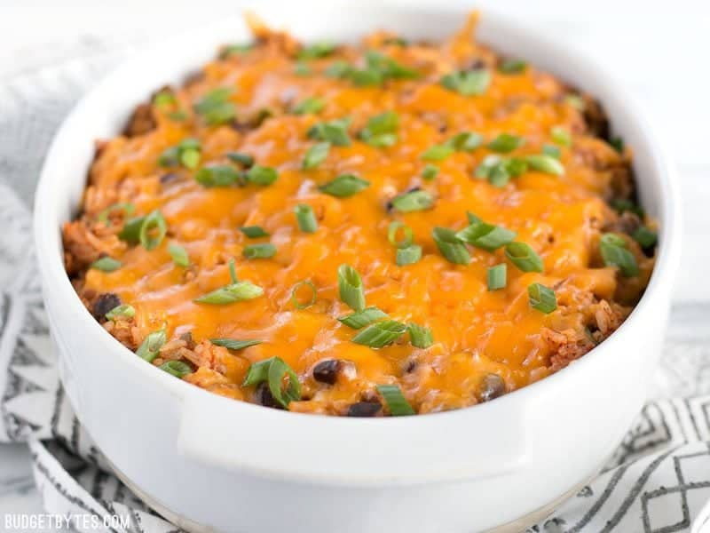 This Beef Burrito Casserole is totally customizable and can include all your favorite burrito or nacho toppings. Leftovers reheat great for lunch! Budgetbytes.com
