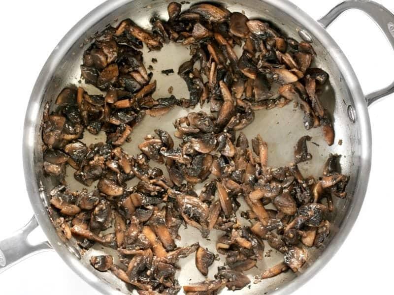 Sautéed Mushrooms in skillet, very brown.