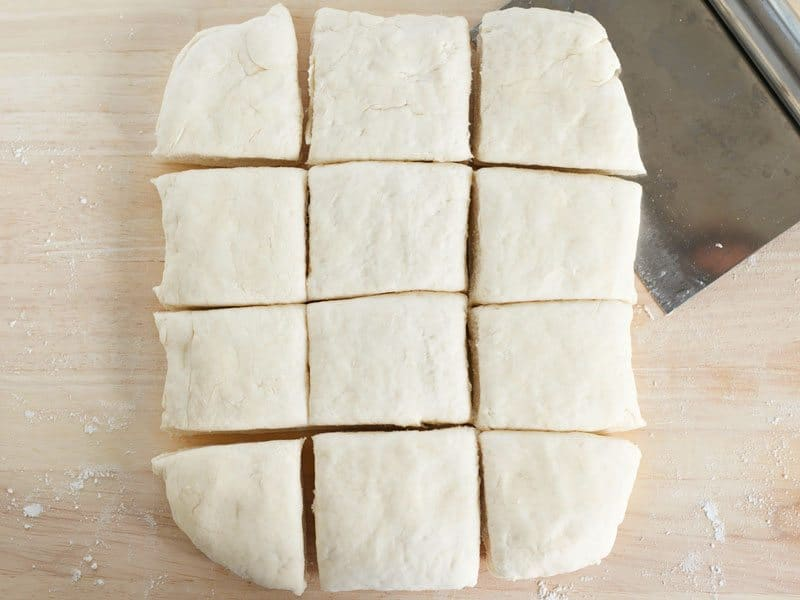 Biscuit dough shaped into a rectangle and cut into squares
