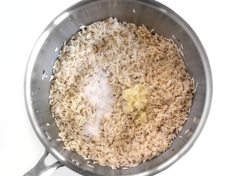 Toasted Rice in the sauce pot with Garlic and Salt