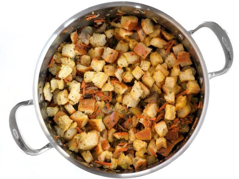 Add Bread Cubes to the pot with the vegetables and walnuts
