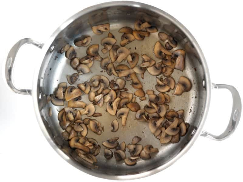 Browned Mushrooms in a large soup pot