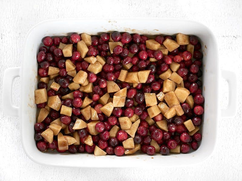 Cranberries and apples tossed in Brown Sugar and Spices in the casserole dish
