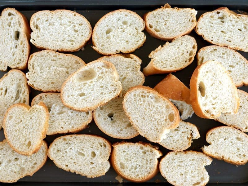 Dry Out Bread by toasting slices in the oven on a baking sheet