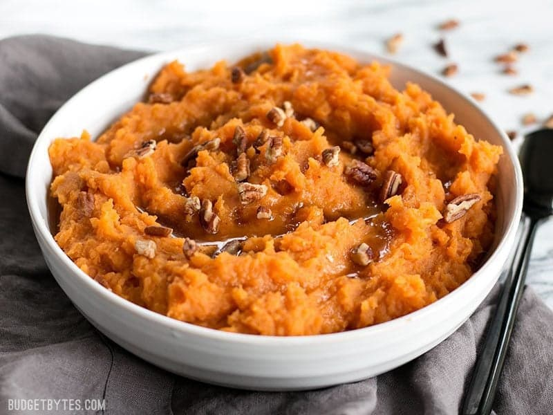 Front view of Maple Brown Butter Mashed Sweet Potatoes with pecans.