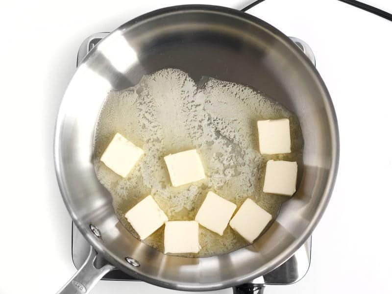 Pats of Butter in the skillet, beginning to melt