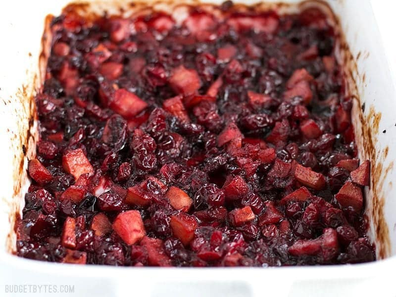 Close up of Roasted Apple Cranberry Relish in the casserole dish, viewed from the front.