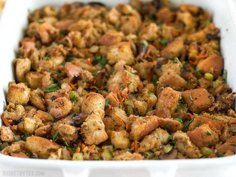 Front view of a casserole dish full of Savory Vegetable Stuffing